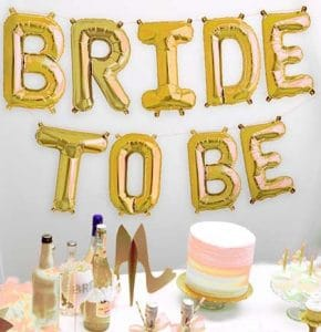 "gold Mylar balloons saying ""bride to be"""
